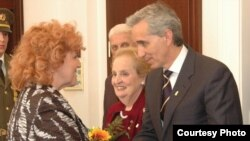 Prague -- RFE/RL President Gedmin receives his award from Defense Minister Parkanova while Ms. Albright looks on.