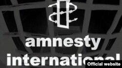 Amnesty International ұйымының белгісі.