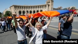 Armenia - Armenian opposition supporters carry a national flag