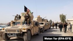Сотрудники сил безопасности Афганистана на патрулировании в афганской провинции Гильменд. 10 января 2019 года.