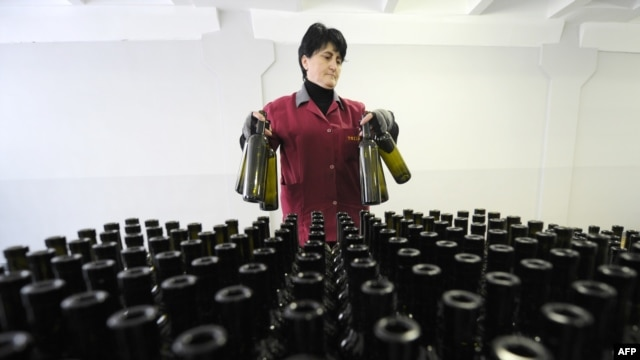 An employee stands in front of bottles at a winery in Tbilisi. (file photo)
