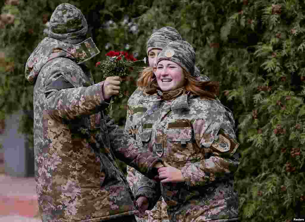 Ukrainian military cadets in Kyiv enjoy a moment of levity on October 25. (Reuters/Gleb Garanich)