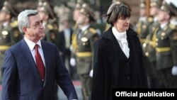 Armenia -- President Serzh Sarkisian and his visiting Swiss counterpart, Micheline Calmy-Rey, inspect the Armenian honor guard outside the presidential palace in Yerevan, 31Mar2011.