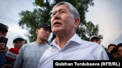 Ex-President Almazbek Atambaev speaks to supporters outside his home near Bishkek on June 27.