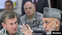 Afghan President Hamid Karzai (right) speaking with General Stanley McChrystal on April 10, 2010 in Kabul