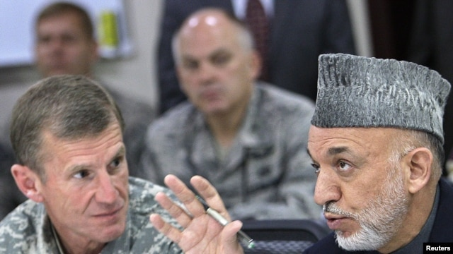 General Stanley McChrystal listens to Afghan President Hamid Karzai in Kabul. Karzai said that the general had cultivated public trust in Afghanistan.