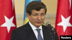 Kazakhstan - Turkey's Foreign Minister Ahmet Davutoglu speaks during a news briefing with Kazakhstan's Foreign Minister Yerlan Idrisov in Almaty, 26Apr2013