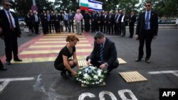 Israel's Tourism Minister Stas Misezhnikov (center right) pays his respects to the five Israeli victims of a suicide blast which targeted a bus of Israeli tourists at Burgas Airport in Bulgaria.
