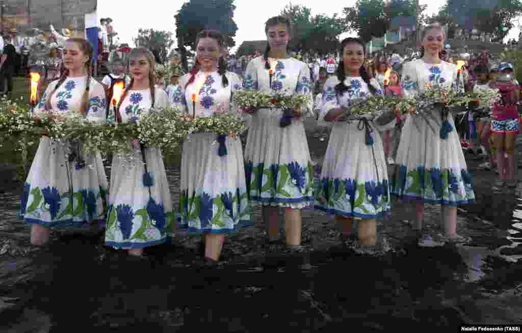 Girls in ethnic costumes carry flower wreaths. Ivana-Kupala​ is considered one of the four main holidays of the solar calendar.