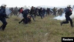 Greek police clash with migrant protesters near the North Macedonia border on April 6.