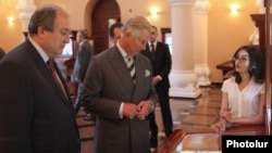Prince Charles (center) and former Armenian Prime Minister Armen Sarkisian visit the Matenadaran museum of Armenian manuscripts in Yerevan on May 28.