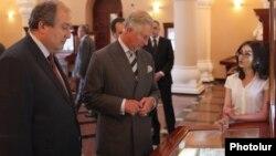Armenia - Britain's Prince Charles (R) and former Armenian Prime Minister Armen Sarkisian visit the Matenadaran museum of Armenian manuscripts in Yerevan, 28May2013.