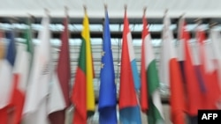 Belgium -- European flags are displayed outside the great hall of the Brussels European Council, 27Jun2012