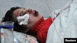 Ukraine -- Opposition activist and journalist Tetyana Chornovol lies on a stretcher at a hospital in Kyiv, December 25, 2013