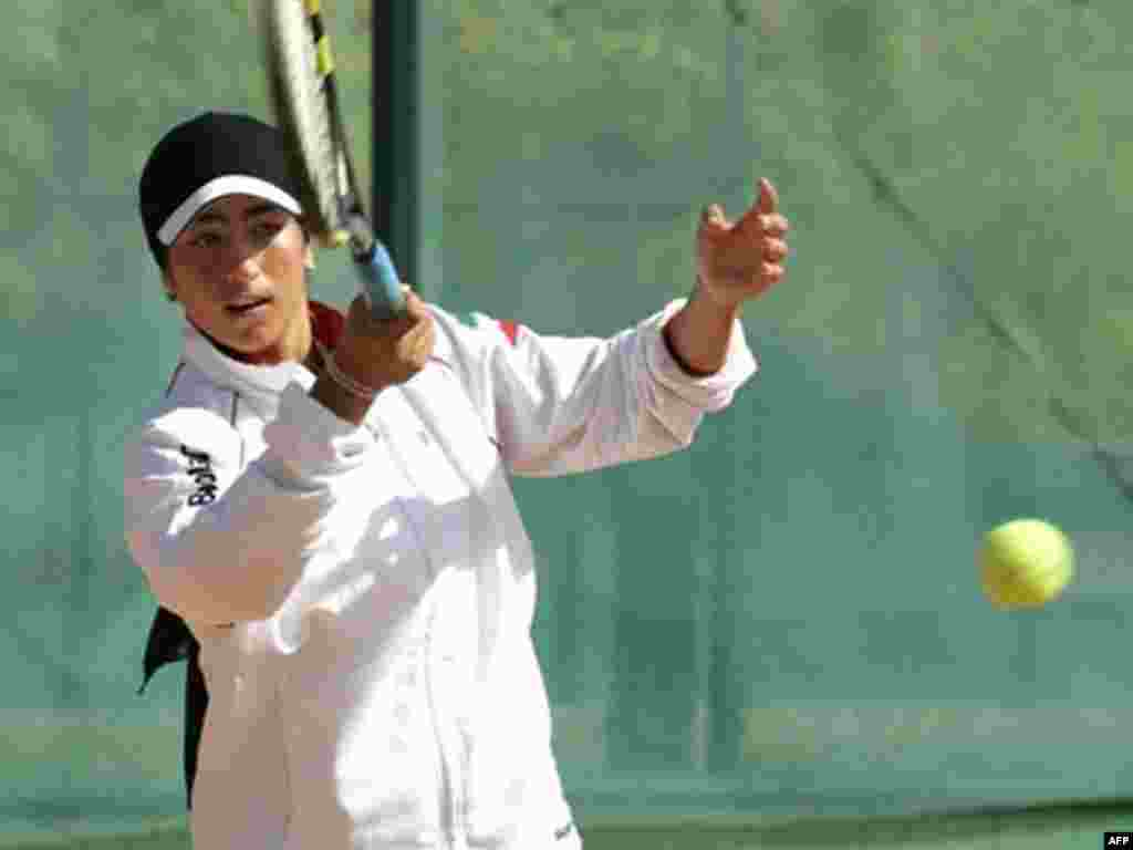 Tennis player Arghavan Rezaei, who plays for both Iran and France, trains before the tennis finals at the Fourth Islamic Women's Games at Tehran's Azadi Stadium in September 2005.