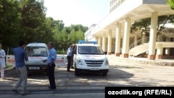 Uzbekistan - Medical emergency units keeping watch near the place, where university exam results are announced