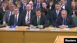 Глава МИ-5 Эндрю Паркер, глава МИ-6 Джон Соэрс и глава Агентства правительственной связи (GCHQ) Иен Лоббан на слушаниях в парламенте Великобритании