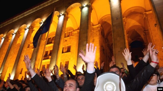 Anti-Saakashvili protesters warmed up the crowd at an event at the same square on April 8, one day ahead of the planned nationwide protests.