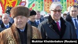 Первый президент Казахстана Нурсултан Назарбаев и вступивший в должность президента после отставки Назарбаева Касым-Жомарт Токаев на праздновании Наурыза в столице. 21 марта 2019 года.