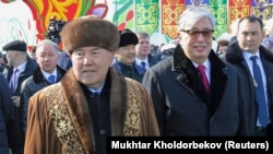 The transition from Nursultan Nazarbaev (left) to Qasym-Zhomart Toqaev has already been bumpier than Kazakhstan's elite may have hoped.