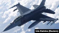 A U.S. Air Force F-16 fighter takes part in an exercise over Estonia in June 2018.