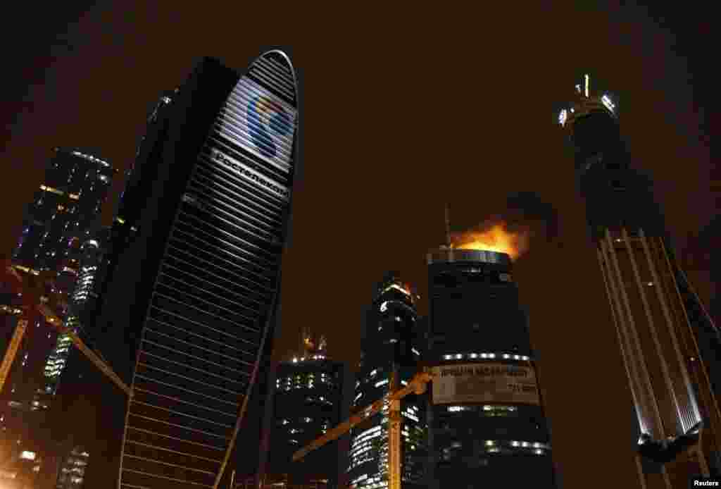 "Russia -- A general view shows a fire burning in the Federation Tower complex of the ""Moscow City"" business district in Moscow, 02Apr2012"