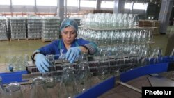 Armenia - A worker at a cannery in Ararat province, 19Apr2014.