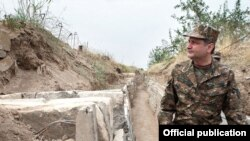 Nagorno-Karabakh - Armenian Prime Minister Tigran Sarkisian walks through a frontline trench, 2Aug2011.