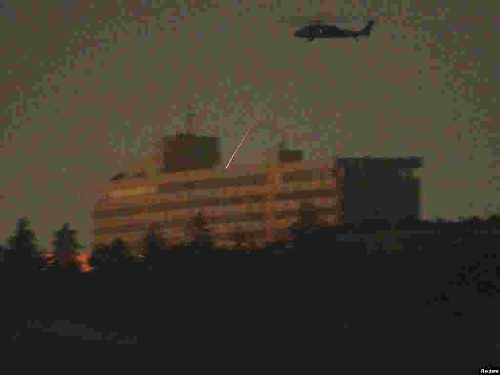 A NATO helicopter fires at the last of the attackers on the roof of the Intercontinental Hotel. (Reuters/Omar Sobhani)