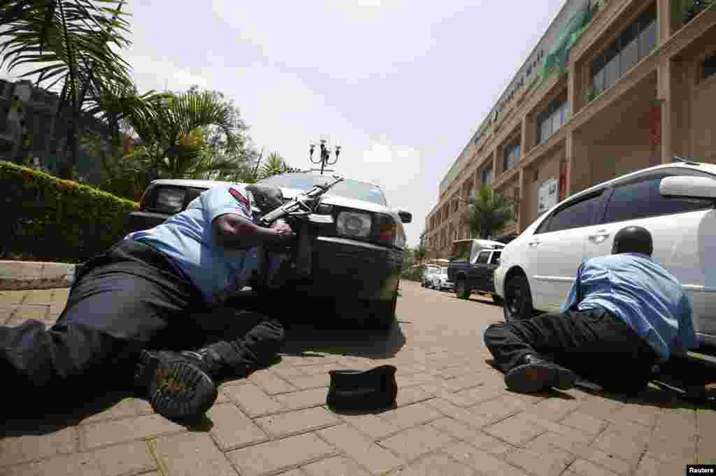 Police take cover outside the Westgate mall on September 21.