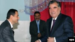 Tajik President Emomali Rahmon (right) at a polling station during presidential elections in Dushanbe on November 6.