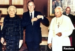 George and Barbara Bush with Pope John Paul II at the Vatican in 1989.