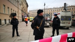 Police guard the entrance to the subway station in St. Petersburg where 14 people were killed on April 3.
