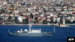A Russian intelligence-gathering ship sails through the Bosphorus past Istanbul.