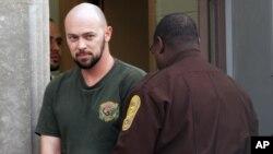 Robert Patrick Hoffman leaves U.S. District Court in Norfolk, Virginia, on December 6, 2012.