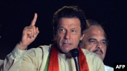 Pakistani opposition politician Imran Khan addresses supporters during a protest march against the country's Pakistan Muslim League-Nawaz-led government in Pakistan's capital, Islamabad, on August 18.