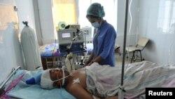 Жаңаөзен ауруханасында жатқан жаралы. 19 желтоқсан 2011 жыл. (Көрнекі сурет)
