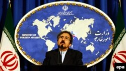 Iranian Foreign Ministry's new spokesman Bahram Ghasemi addresses journalists during his first media conference following his appointment as the ministry's new spokesman, in Tehran, on August 22.