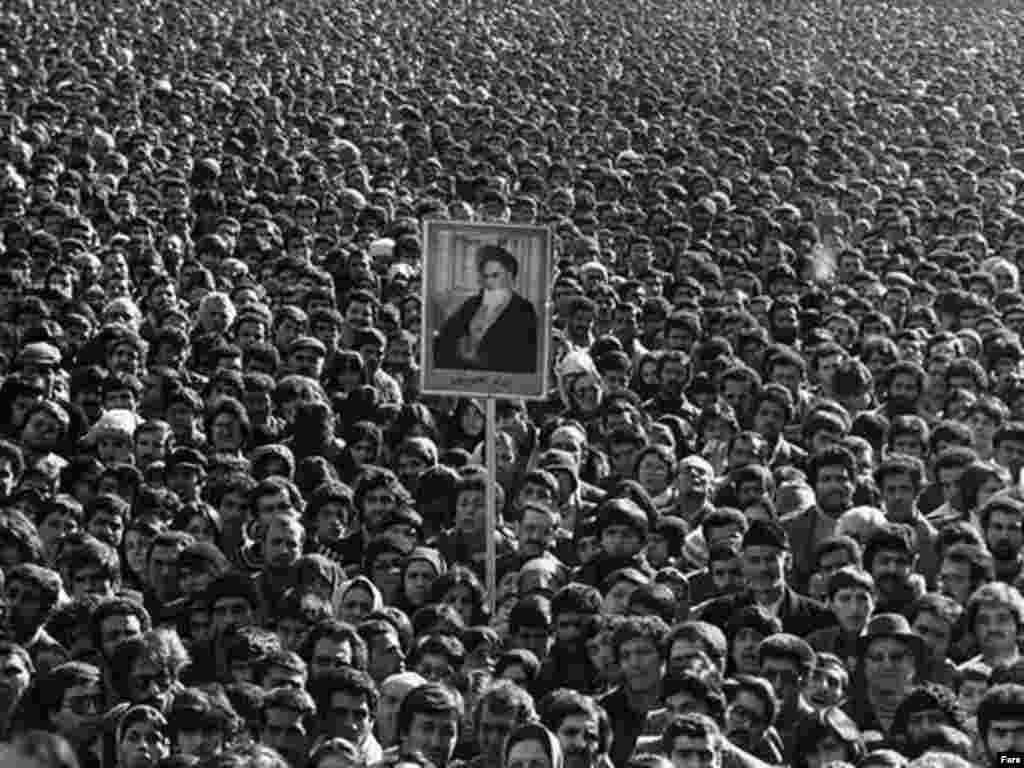 Protesters hold a portrait of Ayatollah Ruhollah Khomeini during the 1979 revolution.