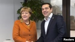 Գերմանիայի կանցլեր Անգելա Մերկելը և Հունաստանի վարչապետ Ալեքսիս Ցիպրասը մասնակցում են միգրանտների հարցով ԵՄ գագաթնաժողովին, Բրյուսել, 7 մարտի, 2016թ.