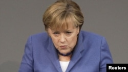 "German Chancellor Angela Merkel said no EU member state would be ""abandoned"" if in financial distress."