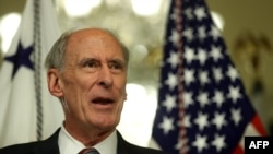 National Intelligence Director Dan Coats speaks to reporters after a swearing-in ceremony at the U.S. Capitol in Washington on March 16.