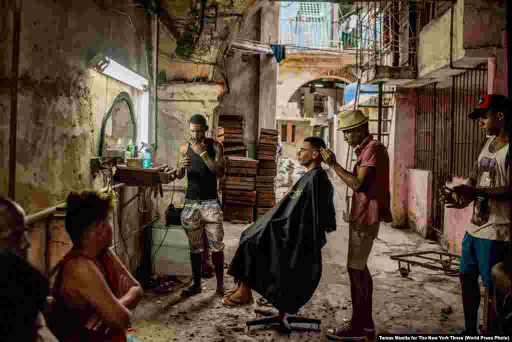 """Cuba On The Edge Of Change"" -- A weathered barber shop in Old Havana.  Daily Life -- First Prize, Stories (Tomas Munita, for The New York Times)"