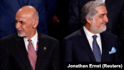 Ashraf Ghani (left) and Abdullah Abdullah both believe they should be president. Will it lead to violence?
