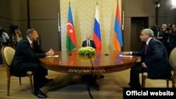 Russian President Vladimir Putin (center) hosts talks between Azerbaijani President Ilham Aliyev (left) and Armenian President Serzh Sarkisian(right).