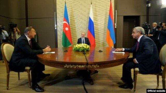 Russian President Vladimir Putin (center) hosts talks between Azerbaijani President Ilham Aliyev (left) and Armenian President Serzh Sarkisian(right).