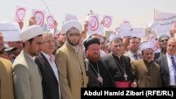 رجال دين مسلمون ومسيحيون يشاركون باحتجاج ضد داعش - عنكاوا 24 تموز 2014