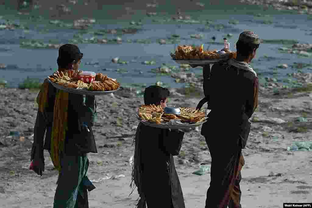 Samosa vendors look for customers at Shuhada Lake in Kabul. (AFP/Wakil Kohsar)