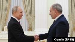RUSSIA -- Russian President Vladimir Putin (L) shakes hands with Armenian Prime Minister Nikol Pashinian before a meeting with leaders of Armenia and Azerbaijan over the Nagorno-Karabakh's future at the Kremlin in Moscow, January 11, 2021
