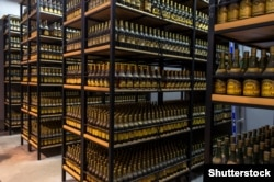 "Bottles of Armenian brandy labelled ""Cognac"" in Cyrillic sit in storage in Yerevan."